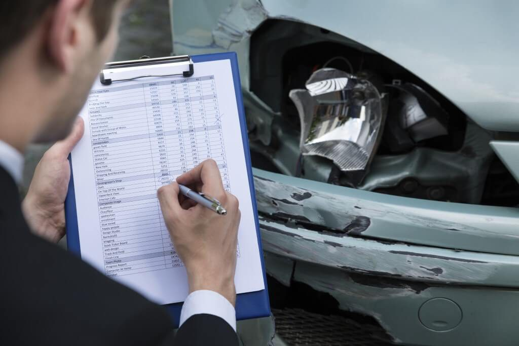 Insurance-Agent-Examining-Car-After-Accident-000062589050_Full-1024x683 (1)
